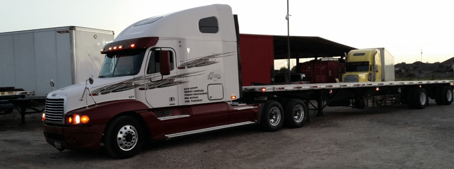 OC Trans Semi Truck Flat bed with white cab.