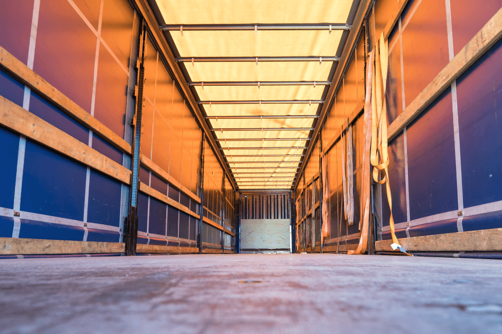 interior of dry-van trailer with straps stored