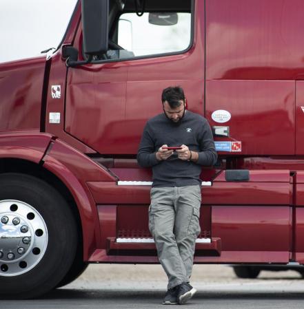 Ilia Jakeli, a Truckstop.com customer, using his smartphone to find and book truck loads on the load board.