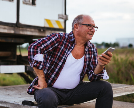A driver uses truckstop.com factoring to get paid while sitting on his truck.