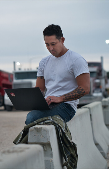 Truckstop.com customer using his laptop to access less than truckload loads.