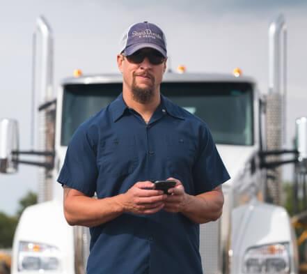 A driver checks the Truckstop.com Load Board for Low Boy Loads